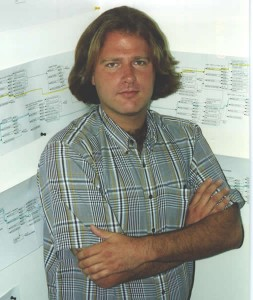 Chris Bankston, Executive Producer at TruVideo, in 1994, standing in front of the decision tree crafted for Surgical Strike.